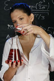 Science. Young woman working on an experiment in her laboratory Stock Photo