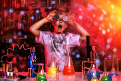 Science. A boy doing experiments in the laboratory. Explosion in the laboratory. Science and education stock photography