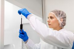 Woman with sulphuric acid in dropper at laboratory Royalty Free Stock Image