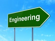 Science concept: Engineering on road sign background. Science concept: Engineering on green road highway sign, clear blue sky background, 3D rendering royalty free illustration