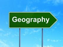 Science concept: Geography on road sign background. Science concept: Geography on green road highway sign, clear blue sky background, 3D rendering Royalty Free Stock Image