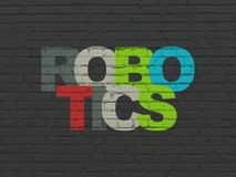 Science concept: Robotics on wall background. Science concept: Painted multicolor text Robotics on Black Brick wall background Stock Image