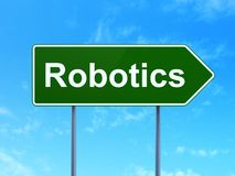 Science concept: Robotics on road sign background. Science concept: Robotics on green road highway sign, clear blue sky background, 3D rendering Royalty Free Stock Photography