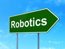 Science concept: Robotics on road sign background. Science concept: Robotics on green road highway sign, clear blue sky background, 3D rendering Stock Photo