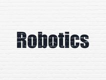 Science concept: Robotics on wall background. Science concept: Painted black text Robotics on White Brick wall background Royalty Free Stock Photo