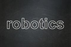 Science concept: Robotics on chalkboard background. Science concept: text Robotics on Black chalkboard background Royalty Free Stock Images