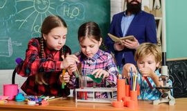 Science and education. chemistry lab. back to school. happy children teacher. children making science experiments stock image