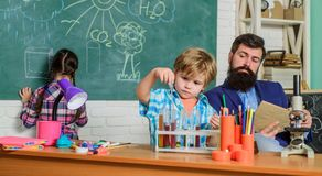Science and education. chemistry lab. back to school. happy children teacher. children making science experiments stock photo