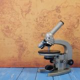 Science and education - Retro microscope map background Stock Image