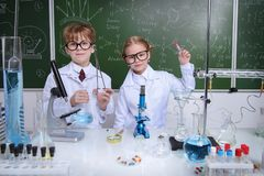 Science and education. Two children scientists making experiments in the laboratory. Educational concept. Early development of children Stock Photo