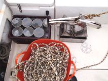 Science equipment for sea research: benthic grab, numbered plastic jars with samples, and hoisting rope on deck of the boat. Science equipment: benthic grab Stock Photography