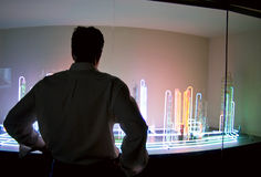 Science Exhibit. A man standing in front of a colorful exhibit in a natural science museum Stock Photo