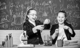 Science experiments in laboratory. Biology lab. Happy Genius. Chemistry research in laboratory. Little girls scientist stock photos