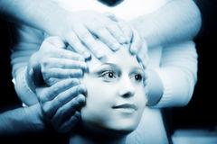 Science fiction concept. Many hands holding a head of young woman. Science fiction concept Stock Photography