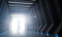 Science fiction interior. An astronaut walking into through an open gate Stock Image