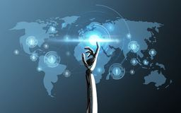 Robot hand touching world map projection. Science, future technology and progress concept - robot hand touching laser light on world map projection over blue Stock Photos