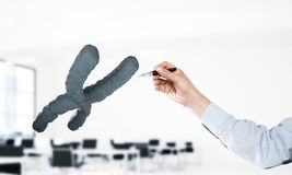 Science and genetics concept with dna molecule. Mixed media. Close of businessman hand and dna molecule on interior background. Mixed media royalty free stock photo