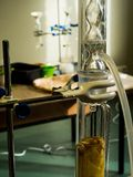 Science glass bottle, Distilling plant for chemical analysis. Laboratory stock photo