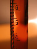 Science - graduated cylinder. Close up on graduated cylinder containing red liquid. You can use it for science or medical design Royalty Free Stock Photos