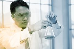 Science health chemical medical concept : scientist analysis che. Mistry liquid tube , selective focus Stock Image