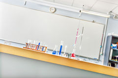 Science items in a laboratory with beakers and tubes Royalty Free Stock Photo