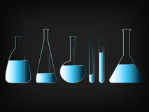 Science lab bottles with liquids Stock Images