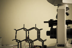 Science lab with chemical theme. Microscope on table for vintage science background Stock Photography