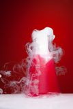 Science lab chemistry experiment. Science lab experiment with smoke coming from the flask Stock Image