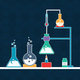 Science lab with labware. Lab experiment objects consist of beaker and flasks with chemical on stylish blue background Royalty Free Stock Photography