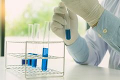 In science lab working test the chemical. In science lab working test the liquid chemical Royalty Free Stock Images