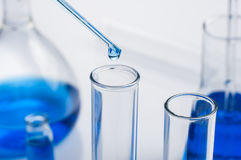 Science laboratory test tubes, equipment filled with blue liquid Royalty Free Stock Photos