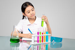 Science. Little asian girl is making science experiments education royalty free stock photography