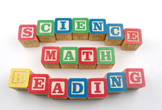 Science Math Reading Blocks. The words science, math, reading spelled out with wooden blocks  on white background.  Great for back to school content Royalty Free Stock Images