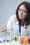 Science and Medicine Concepts. Portrait of Female Lab Staff Dealing with Liquids Royalty Free Stock Images