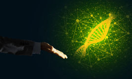 Science medicine and technology concepts as DNA molecule on dark background with connection lines Royalty Free Stock Image