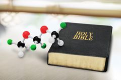 Science and Religion. Evolution Bible Creation creationism Origins Molecule Royalty Free Stock Photography