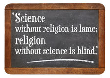 Science and religion. Science without religion is lame, religion without science is blind - a quote from Albert Einstein on a vintage slate blackboard royalty free stock photo