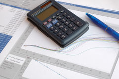 Science reports 2. Science reports with graphs on the table with blue pen and calculator Stock Photography