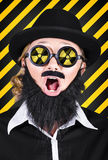 Science research geek with atomic discovery. Science research geek wearing nuclear symbol on glasses expressing shock in an atomic discovery. Mad scientist Royalty Free Stock Photo