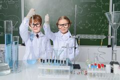 Science in school. Two children scientists making experiments in the laboratory. Educational concept. Early development of children Royalty Free Stock Photos