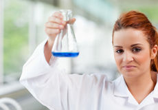 Science student holding an Erlenmeyr flask Stock Photography