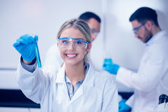 Science student holding up test tube. At the university Stock Images