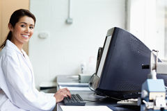 Science student with a monitor Royalty Free Stock Photos