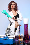 Science Student in Sexy Clothing Experimenting Stock Photo