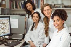 Science students smiling at camera Stock Image