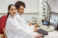 Science students working with microscopic image on computer Royalty Free Stock Photography