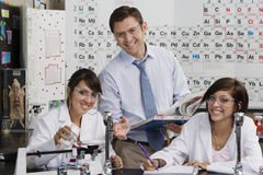Science Teacher Assisting Student Royalty Free Stock Image