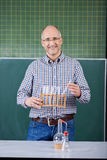 Science teacher conducting an experiment Royalty Free Stock Photo