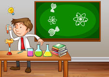 Science teacher experimenting in classroom Stock Photo