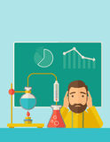 Science teacher in laboratory. A science teacher with scared facial expression works on mixing chemicals for an experiment in the laboratory. A Contemporary Royalty Free Stock Photo